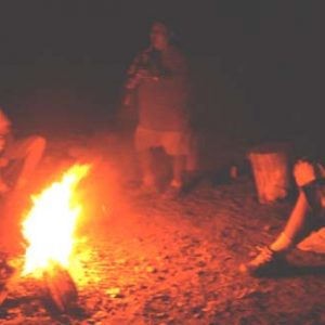 Campfire circle and fire blessing ceremony with Navajo leader in Canyon de Chelly.