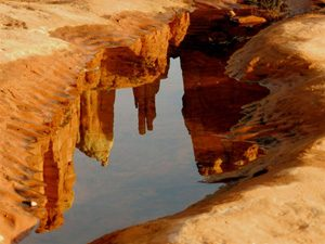 Sedona red cliff landscapes reflected in water is symbolic of Sedona as a powerful place for vision quest