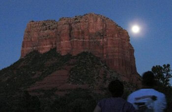 Full moon rising behind a red butte signifies a ceremony to align with the greater self.