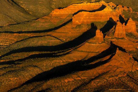 Lovely Sedona shadowy cliffscapes image by Ted Grussing. This speaks to me of seeing different aspects or dimensions of the usual reality.