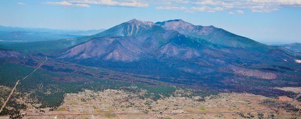 Photo of east side of Peaks showing decimation of the forestfive days later.