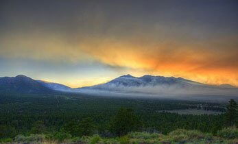 Day 4 panorama photo shows fire is still burning over a large area..