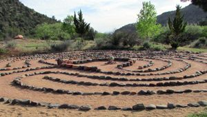 Labyrinth with trees in background speak of Fall Equinox ceremony to create a new balance