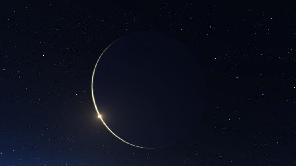 new moon sliver against a black sky symbolic of return of the light at Winter Solstice and spiritual retreat in Sedona, Arizona