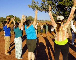 Sedona Ceremony held in honor of the solar eclipse; photo depicts the open-hearted dedication to work together and the joyful energies created in ceremony.