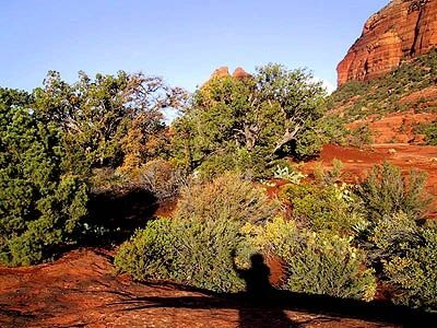 Shadow of a solo person in red cliffs of Sedona, Arizona practicing mystic vision skills in nature.