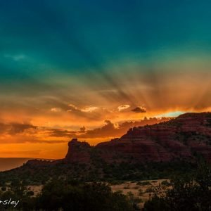 Sedona sunset over cliff silhouette invites connection with the spiritual energies of sunset, moonrise and stars.