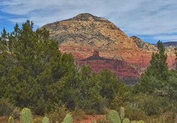 View of Thunder Mountain and Chimney Rock, Sedona from a scenic red rock vista where we do circles and outdoor seminars.