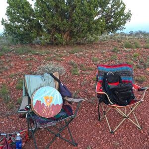 2 chairs with a drum and a day pack symbolize Sedona outdoor programs in nature and discover Sedona circle
